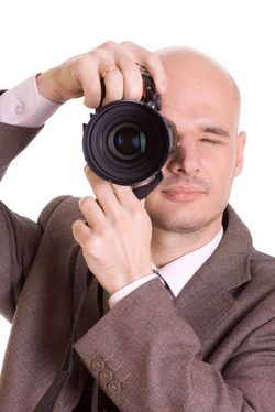 Shutterstock_fotografen_im_Anzug
